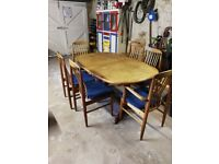 Solid teak extendable dining table with 6 chairs . Well used and loved