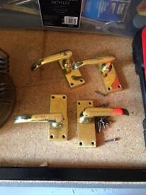 Four brass door handles