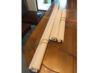 Three Ivory roller blinds