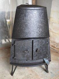 Woodburning Stove will run several radiators and heat water.