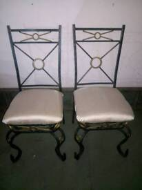 2 wrought iron and cream dining chairs