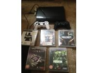 PS3 slim 120gb with 2 controllers and 5 games