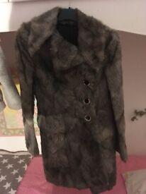 Ladies brioni fur coat genuine.