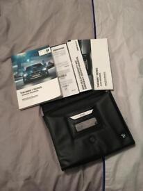 BMW 1 series owners handbook/wallet
