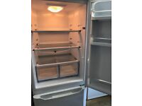 Tall frost fre fridge freezer for sale