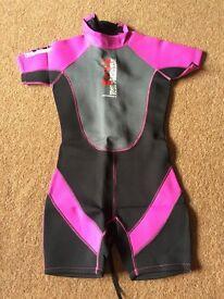 Various size children's wet suits