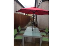Garden table chairs with umbrella
