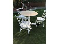 Pedestal table and three chairs ( can deliver )