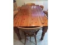 Solid pine kitchen table and 6 chairs Antique pine colour . In vgc.