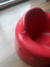 Red bumbo chair with a tray