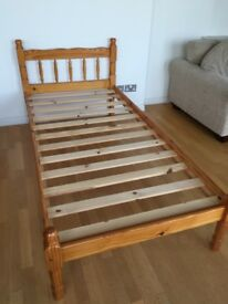 Pine single bed in excellent condition. Mattress included.