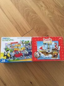 Two child's puzzles traffic jam and pirate ship