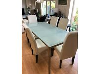 Table and free chairs - Silver Rotating Dwell dining chairs
