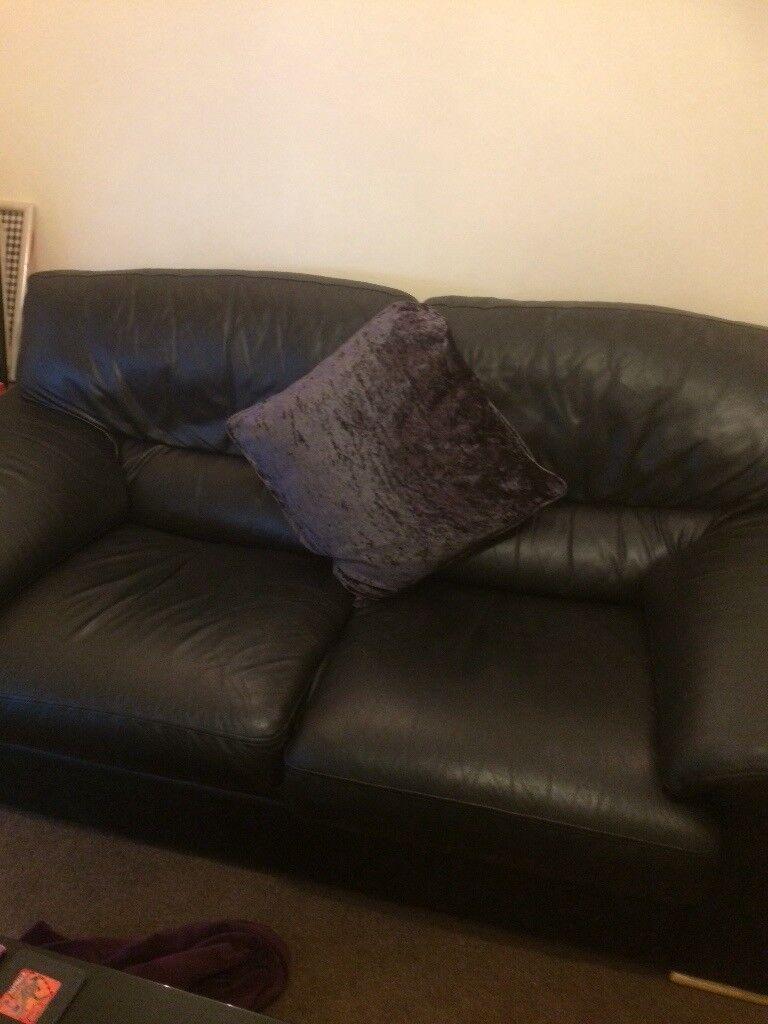 2 x black leather sofas good condition