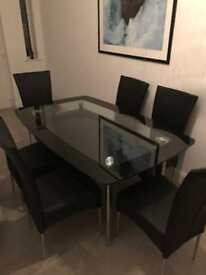 Large black glass dining table with six chairs- immaculate condition
