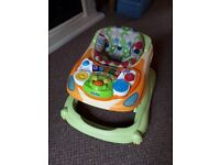 Baby walker excellent used condition, lights and sounds, removable tray