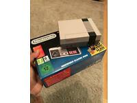 Mini nintendo classic and spare controller (not original) £130