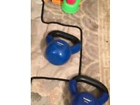 Three kettlebells and other weights thrown in
