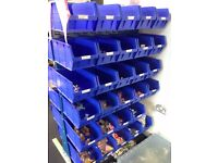 Blue Stacking Shelves and Buckets - Six Rows, 56 Buckets Available.