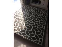 Indoor/outdoor new rug