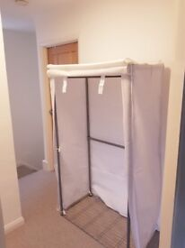 Sturdy Grey metal clothes rail with linen cover.