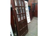 Exterior hardwood door with crazed glass squares