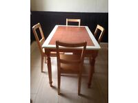 Kitchen table with terracotta tiled top and 4 chairs in good condition