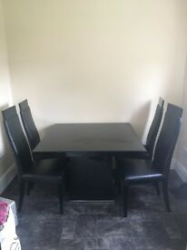 Black high gloss table with glass top and 4 x chairs