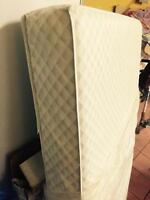 Crib mattress and used fitted sheets