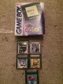 Boxed purple gameboy color and vanes