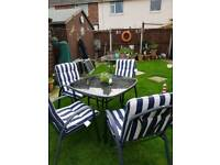 Garden table, umberella and 4 chairs