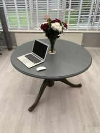Grey round dining table