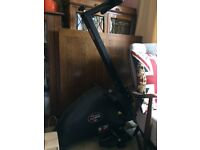 Folding body sculpture magnetic rowing machine,