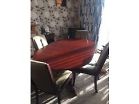 For sale - mahogany drop leaf dining table with 4 green chairs