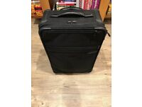 Carry-on size Briggs and Riley suitcase
