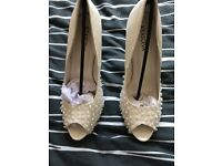 Ivory shoes size 7