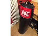 Boxing punch bag and gloves
