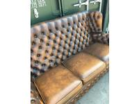 Gold brown leather buttoned chesterfield sofa