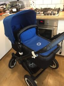 Bugaboo Buffalo with royal blue fabrics and footmuff. Reduced price