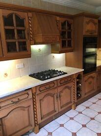 Farmhouse style kitchen with appliances for sale.