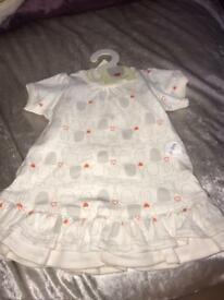 Natures purest 0-3months baby girls dress with sock. New with tags