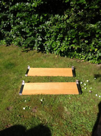 4 IKEA wall shelves in light wood with metal brackets