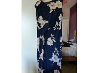 Flattering floral dress, ideal for weddings. Size 10. Excellent condition.