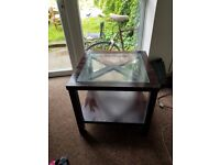 2 strong glass topped coffee tables