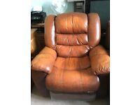 Tan leather rocker recliner armchair.