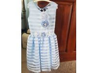 Childrens party dress by Daga. Age 6-7 years. Perfect for a special occasion. Brand new.