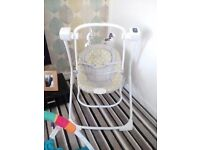 Graco baby swing and bouncer, plays music and as vibrate function. Mains and battery operated.