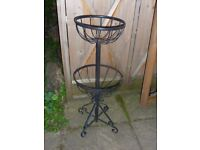 Metal twin planter stand.