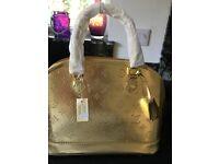 LOUIS VUITTON GOLD HAND BAG