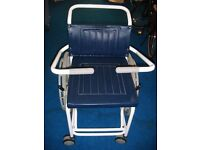 Day's Medical Attendant-propelled shower commode chair with gull wing arms